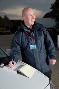 Professional security services doing keyholder patrol inspections on business premises